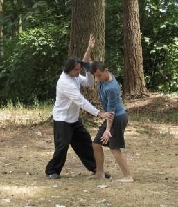 "Bagua Zhang Instructor Dennis Mace correcting a student's posture in ""Zhi Tian Cha Di"""